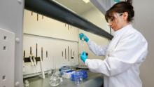 woman in mycotoxin laboratory